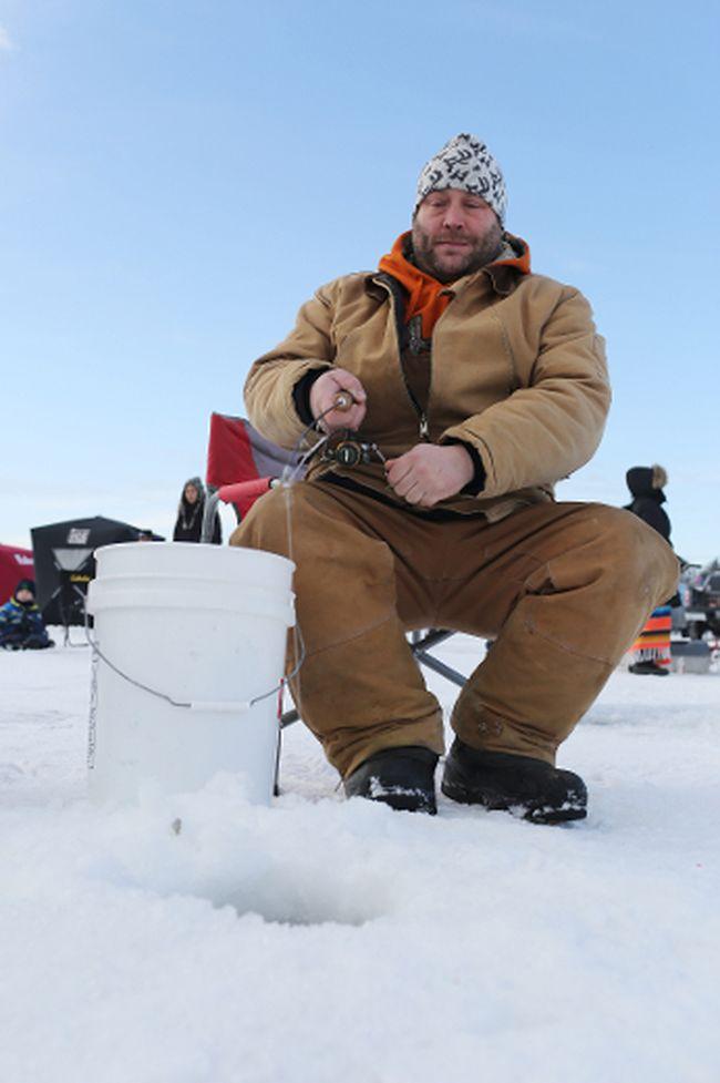 Zeke Ivory takes part in the 2018 KidFish Ice Fishing Derby. (Brook Jones/Selkirk Journal/Postmedia Network)