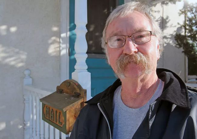 Ted Moyes outside his home on Montreal Street in Kingston.  Steph Crosier/Postmedia