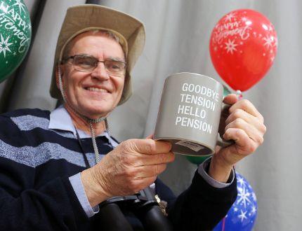Phil Veness holds up a coffee mug at his retirement event at Centennial School Jan. 17. (Brook Jones/Selkirk Journal/Postmedia Network)