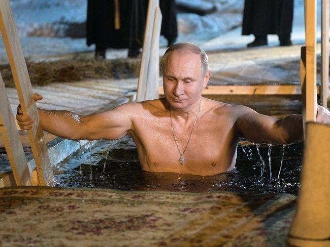 Russian President Vladimir Putin bathes in an ice-cold water on Epiphany neat St. Nilus Stolobensky Monastery on Lake Seliger in Svetlitsa village, Russia, Friday, Jan. 19, 2018. Alexei Druzhinin / AP