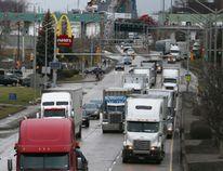 Thousands of trucks travel south on Windsor's Huron Church Road after exiting the international border crossing at the Ambassador Bridge. (NICK BRANCACCIO/Postmedia News)