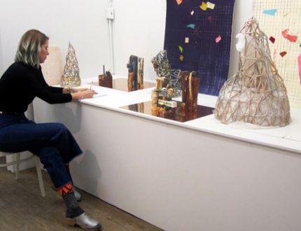 April Martin of Manitoulin Island installs her work at Artists on Elgin. Her show Efflorescence runs until Jan. 30. (Photo supplied)