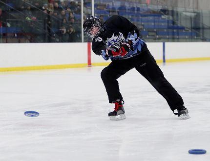 Jorja Prokopich competes in the hardest shot at the 2017 Winnipeg Ringette League Skills Competition at the Seven Oaks Arena Dec. 30, 2017. (Brook Jones/Selkirk Journal/Postmedia Network)