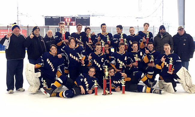 The Sarnia Sabers midget select team celebrates its victory at the 2018 Gene Harrington Invitational hockey tournament in Niagara Falls, N.Y. (Contributed Photo)