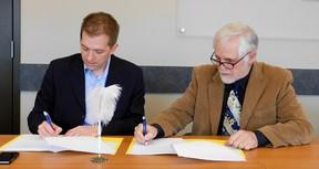 Gateway Director, Jay McFarlan with Chris Lee Vice Chair of G2G Rail Trail, signing a Memorandum of Understanding. (Kathleen Smith/Goderich Signal Star)