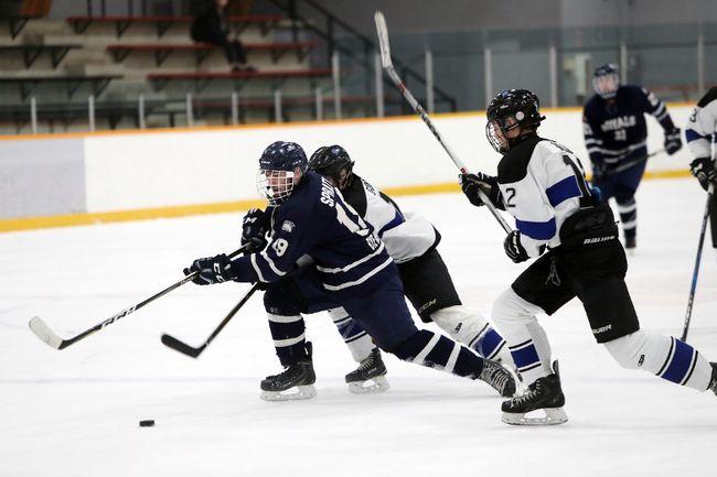 The Lord Selkirk Royals boys' hockey team battles the Oak Park Raiders at the Eric Coy Arena Jan. 26. (Brook Jones/Selkirk Journal/Postmedia Network)