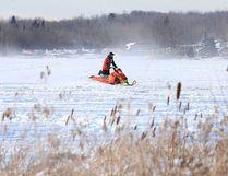 A snowmobiler makes their way across Whitewater Lake near Sudbury earlier this winter. (Gino Donato/Postmedia file photo)