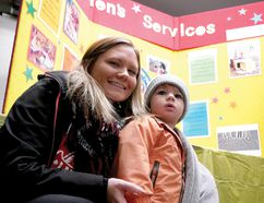 Chris Abbott/Postmedia News Brittany McCurdy and Jensen Stuyt enjoyed Friday's Family Literacy Festival in Tillsonburg, which included book reading by children's author Barb Chrysler.