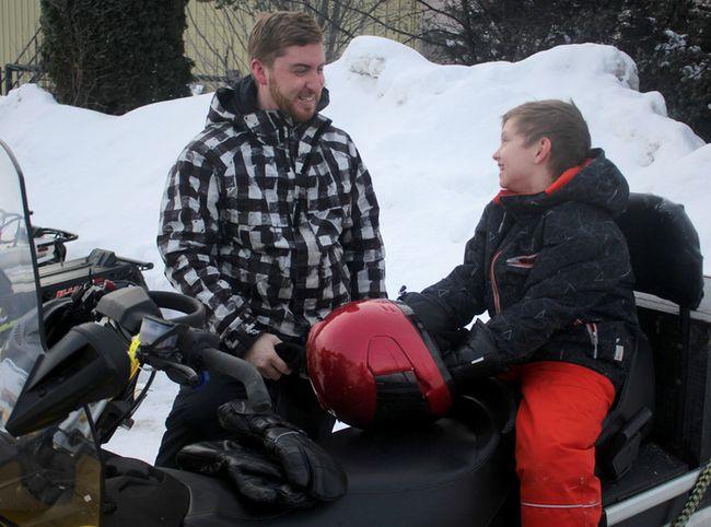 Adam Hay speaks with his son, Kieran Hay, at the 44th annual Snowarama.