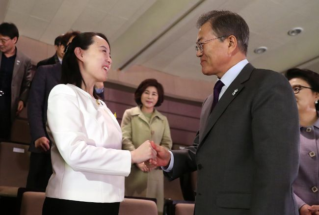 South Koran President Moon Jae-in, right shakes hands with Kim Yo Jong, North Korean leader Kim Jong Un's sister, after a performance of North Korea's Samjiyon Orchestra at National Theater in Seoul, South Korea, Sunday, Feb. 11, 2018. (Bee Jae-man/Yonhap via AP)