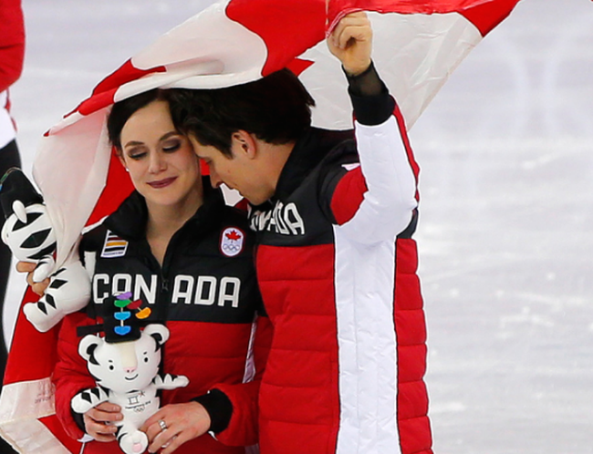 Tessa Virtue and Scott Moir celebrate Canada's figure skating team event gold medal. Leah Hennel / Postmedia