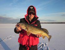 Avid ice-fisherman Grant Bailey with a nice winter walleye.