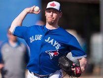 Toronto Blue Jays pitcher John Axford pitches at Spring Training in Dunedin, Fla. THE CANADIAN PRESS/Frank Gunn