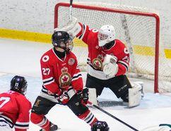Goalie Blair Coffin makes a blocker save Thursday during a Jr. 'B' hockey game that saw the Sarnia Legionnaires trounce the St. Marys Lincolns 8-2. (Photo courtesy of Shawna Lavoie)