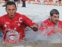 Patrick Brown and Ross Romano participate in Ontario Winter Carnival Bon Soo's Polar Bear Swim in 2017.