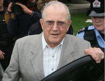 Police officers escort Father Charles Sylvestre after leaving a Chatham courtroom on Sept. 22, 2006. (DAN JANISSE / WINDSOR STAR)