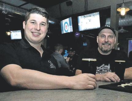 Herald Haus Brewing Co. head brewer Jeff Macdonald and managing partner Dan Graver celebrate the launch of Dingman Dark lager Friday in Stratford. (GALEN SIMMONS/Postmedia News)