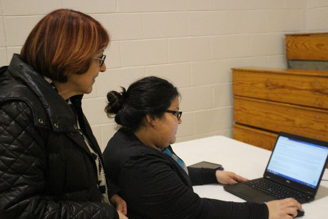 Aamjiwnaang Chief Joanne Rogers, left, and Courtney Jackson explore the new air-quality website, cleanairsarniaandarea.com. (NEIL BOWEN/Sarnia Observer)
