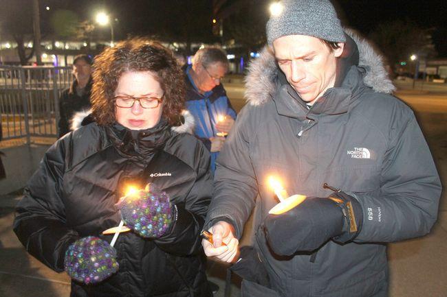 Around 30 people attended Thursday's vigil in downtown Sarnia. (Carl Hnatyshyn/Postmedia News)
