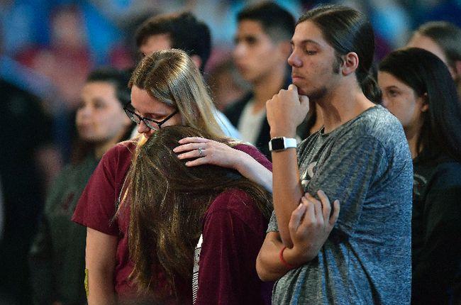 Marjory Stoneman Douglas High School students listen to sheriff Scott Israel speak before a CNN town hall broadcast last Wednesday, Feb. 21, 2018, at the BB&T Center, in Sunrise, Fla. Michael Laughlin/South Florida Sun-Sentinel via AP