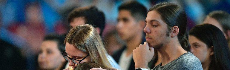 Michael Laughlin/South Florida Sun-Sentinel via AP Marjory Stoneman Douglas High School students listen to sheriff Scott Israel speak before a CNN town hall broadcast, Wednesday, Feb. 21, 2018, at the BB&T Center, in Sunrise, Fla.