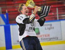 Holy Trinity captain Lexi Paulmert celebrates her team's NSSAA girls hockey title Tuesday at Holy Trinity. Paulmert scored a goal in a 4-1 win vs. Simcoe Composite. JACOB ROBINSON/Simcoe Reformer