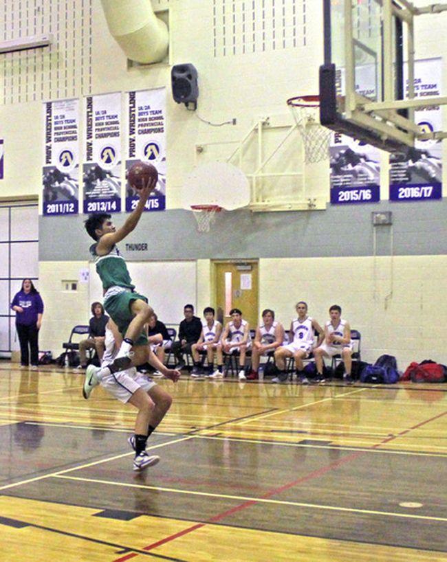 St. Timothy High School won a close 69-68 game in senior boys' basketball action against St. Martin de Porres.
