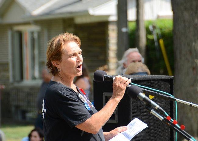 Debi Wells speaking at a Labour Day event in Skeleton Park. Photo Jamie Swift