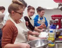 Jenna Yaremchuk Olivia Millier and Kalara Fradette work on their team's carrot and zucchini cake with cream cheese icing. - Photo by Josh Thomas