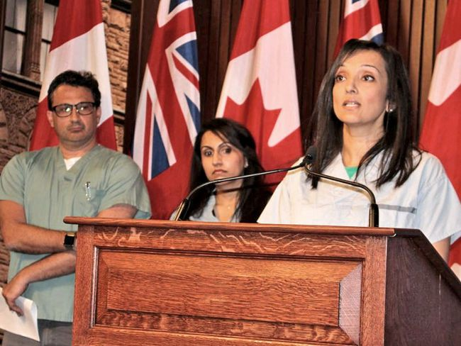 Dr. Deron Brown, Dr. Kulvinder Gill and Dr. Ashvinder Lamba speak at Queen's Park on Tuesday. (Antonella Artuso/Postmedia)