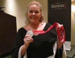 Elizabeth Manley holds her Silver medal from the 1988 Calgary Olympics. Manley spoke Thursday at the Enbridge Famous 5 Speaker Series at the Holiday Inn in Point Edward. (Paul Morden/Sarnia Observer)