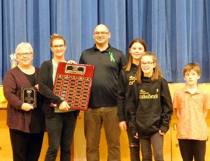 The Fairview Minor Hockey Founders Award was awarded to Joe Hemstock, accepted by Cathy McDonald. From left to right: Cathy McDonald, Jamie Parliament, and Joe Hemstocks Great-Grandkids - Maddie Avignon, Reegan McDonald & Treyton McDonald.