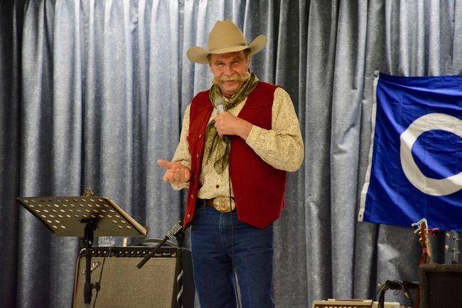 Bryan Smith reading his poetry at the Whitecourt Seniors' Circle on April 21. (Taryn Brandell | Whitecourt Star)