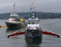 Oil skimming vessels practice in Burrard Inlet.