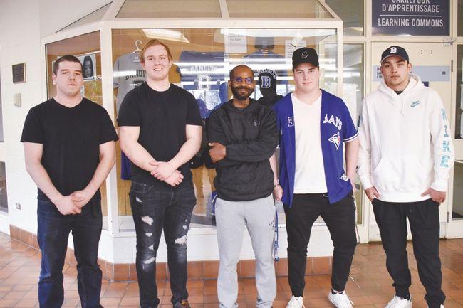 (L-r) Bandits football players Austin McLelland, Noah Danyk-Purcell, coach OJ Lepps, Jared Sawa and Stefan Zec.
