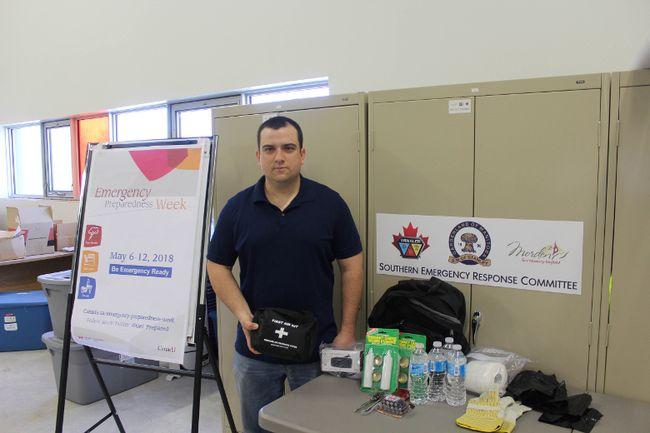 SERC Emergency Coordinator Darin Driedger shows a simple emergency kit. (GREG VANDERMEULEN/Winkler Times)
