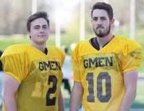 Limestone District Grenadiers senior varsity quarterbacks Drew Freake, left, and Ben Maracle are seen at practice on Wednesday night at Richardson Stadium. (Steph Crosier/The Whig-Standard/Postmedia Network)