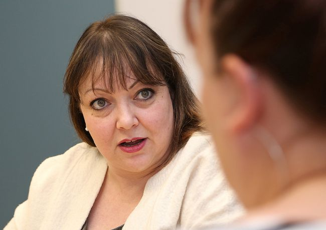 Natalie Mehra, executive director of the Ontario Health Coalition, speaks to Sudbury Star reporter Mary Katherine Keown in Sudbury on Friday. John Lappa/Sudbury Star/Postmedia Network