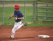 Hawk Jaxson Deitz scores a run for County Central High School's baseball team Thursday during a game against Nanton's J.T. Foster High School in Nanton. Photos by Stephen Tipper Vulcan Advocate