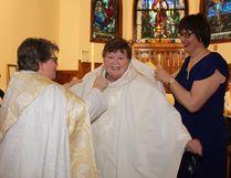Rev. Belair was vested by her daughter Karen Belair Girard and Archdeacon Deborah Lonergan-Freake.