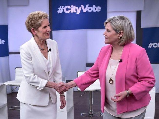 Liberal Premier Kathleen Wynne and NDP Leader Andrea Horwath shake hands at the Ontario Leaders debate in Toronto. THE CANADIAN PRESS/Frank Gunn