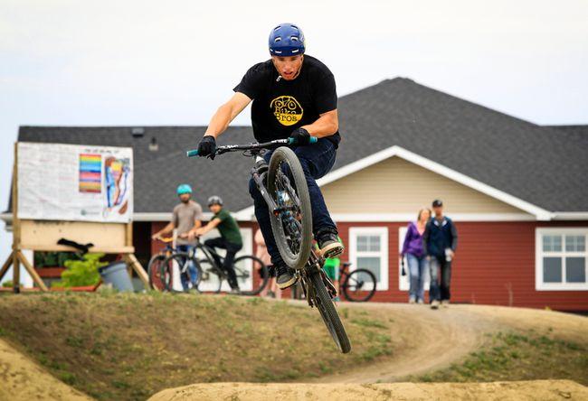 Scott Thornhill of Hoots and Cochrane, Alta.'s Bike Bros, does a few runs of the Blackfalds Bike Skills Park during its grand opening on Saturday afternoon.(Ashli Barrett/Lacombe Globe)
