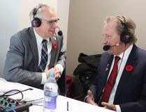 Jack Miller (left) in the broadcast booth at Yardmen Arena with B-Sens owner Eugene Melnyk during the AHL team's inaugural 2017-18 season in Belleville. (CJBQ photo)