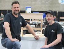 Teacher Bryan Derksen is seen with Ballagh.