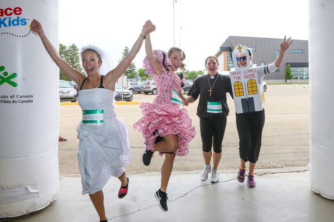 Winning team For The Kids crosses the finish line of the Flaman Race for Kids June 9. From left: Nikola Effert, Kristi Mellom, Christie Chrunik, and Tara Myers. (Sarah O. Swenson/Wetaskiwin Times)