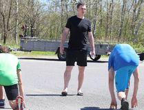 Brock McGillis runs fitness camp members through a drill in Sudbury, Ont. on Tuesday June 19, 2018. Gino Donato/Sudbury Star/Postmedia Network