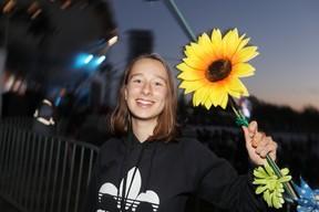 Rachelle Lambert, 15, shows a little flower power while attending the 45th annual Winnipeg Folk Festival at Birds Hill Provincial Park, south east of Selkirk, on July 5. (Brook Jones/Selkirk Journal/Postmedia Network)