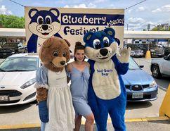 Sabrina Bear and Sud-Berry Bear pose with festival coordinator Katlyn Kotila at The Market in downtown Sudbury on Tuesday. (Julia Lloyd/For The Sudbury Star)