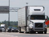 Transport trucks travel Highway 401 in Kingston, Ont. on Thursday July 12, 2018. Steph Crosier/The Whig-Standard/Postmedia Network