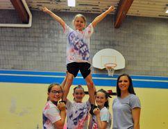 Norfolk County hosted a cheerleading camp at West Lynn Public School last week. Pictured is Delhi's Taya Walters, Payton Tatarka of Simcoe, Brenna Pilgrim of Port Dover, Simcoe's Brooke Calhoun and coach Ashley Sherman of Delhi. JACOB ROBINSON/Simcoe Reformer